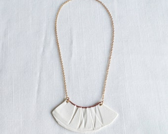 RUCHED No1 artisan white porcelain bib necklace with copper accent and gold chain
