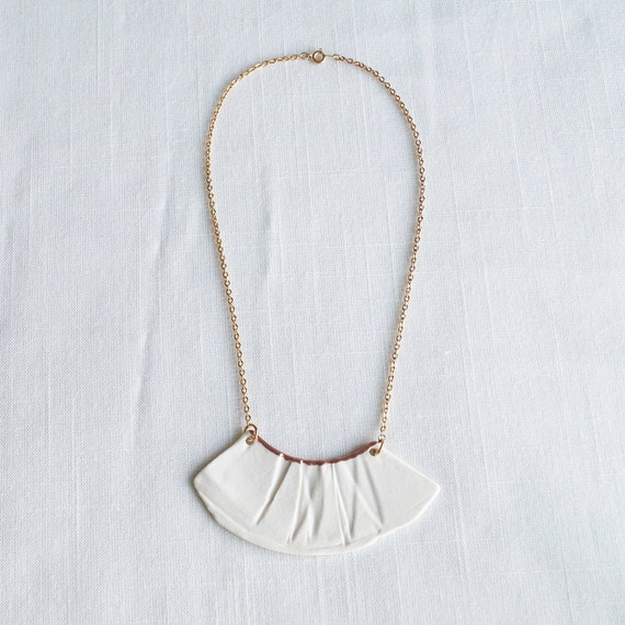 RUCHED No1 artisan white porcelain bib necklace with rose gold accent and gold chain