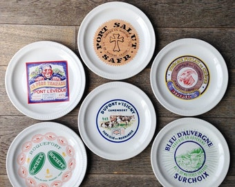 French cheeses on a plate. Perfect set of 6. Retro labels advertising souvenir from France. Rustic shabby chic cottage farm table setting.