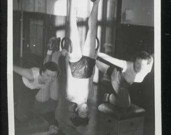 vintage photograph of four smiling female gymnasts working out c. 1930s