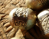 Moroccan very tarnished large ornate bead with gold colour tint with three loops