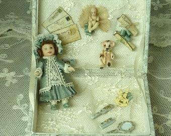 Miniature doll in a rectangular display box