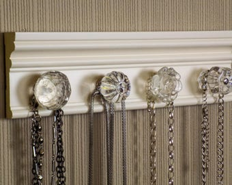 """OFF White necklace rack. This jewelry organizer wall hanging features 4 clear glass or acrylic decorative knobs total /12 """" jewelry storage"""