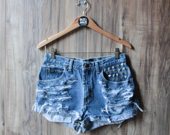 High waist vintage studded denim boyfriend shorts | Ripped distressed shorts | Silver pyramid studded pocket | Hipster festival shorts |