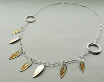 Glow Necklace, modern and elegant silver and gold mixed metal necklace with a bohemian western feel.