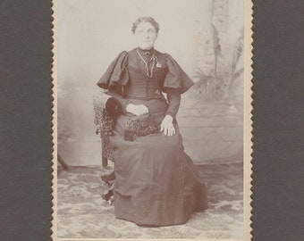 Cabinet Card of a Woman Showing Off Her Fancy Purse