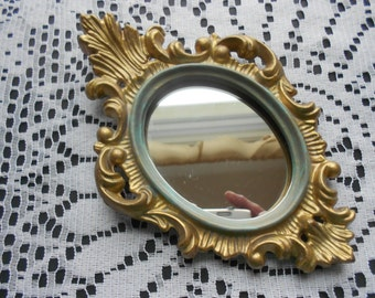 Vintage oval wall mirror in Syroco, Baroque style
