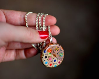 Cute little locket made of classic and magic colored pencils
