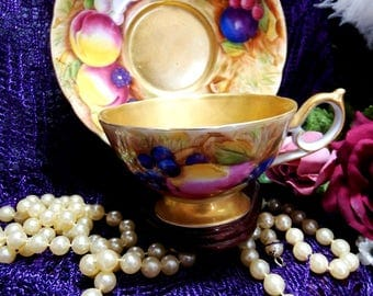 Circa 1950s, Elegant American Beauty, Tea Cup and Saucer, Gold with a Fruit Motif, Made in Occupied Japan