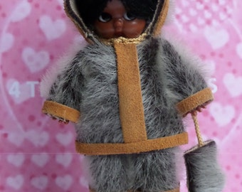 Vintage 1970s hard plastic Eskimo / Inuit doll  with side glancing eyes and starfish hands