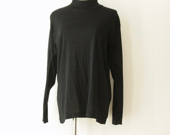 90s black turtleneck blouse. Black minimalist top. Black high neck top. 90s Godard top. Witchy woman. French avant garde. Black top. Size L
