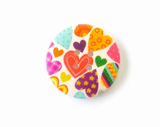 50mm wooden button featuring lots of different coloured hearts