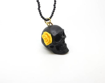 Skull and yellow flower necklace