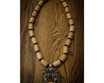 Wood Lion Pendant on Brown Barrel Bead Necklace