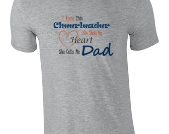 Cheer dad shirt.  I know this cheerleader, she stole my heart, she calls me dad. Cheer dad tshirt. Cheerleading tshirt. cheerleader dad tee