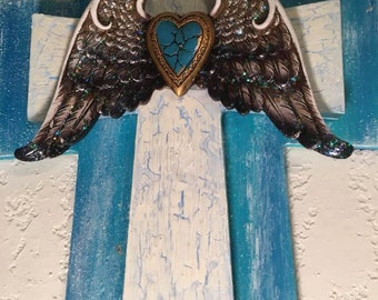 sea blue and white wood cross with wings