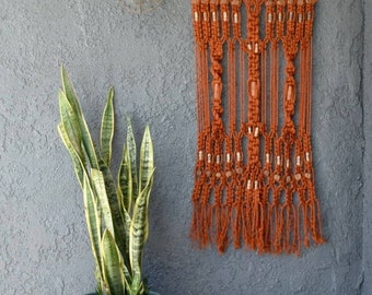 vintage orange macrame wall hanging
