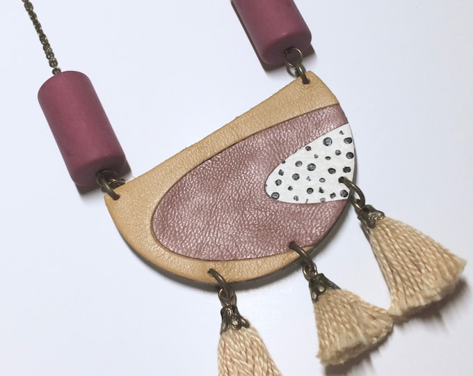 Cozy tea rose leather pendant with two vintage  matte mauve lucite beads and three beige cotton tassels