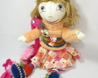 Rag doll with flamingo.