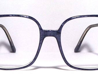 Vintage eyewear. Awesome large size frame! Made in Germany. 1980's. Deep blue marble color. Excellent condition and quality! Rad!