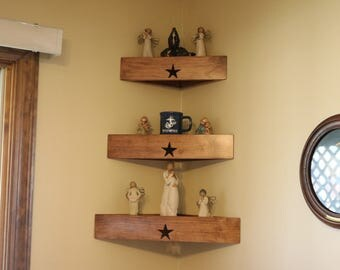 Set of three decorator wood corner wall shelves with star.