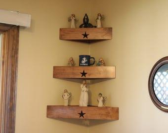 Set of three decorator wood corner wall shelves with star.