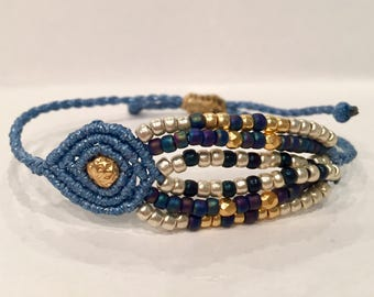Tribal evil eye with beads shiny baby blue
