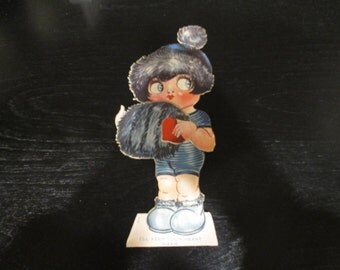 Vintage Girl with fur muff - moveable valentine with black fur hat and muff with fur on shoes as well.  Made in Germany,  1930's or earlier