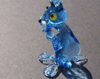 Blue bunny with adorable face expression. Detailed figurine with a lot of personality.  Excellent addition to your glass animals collection.