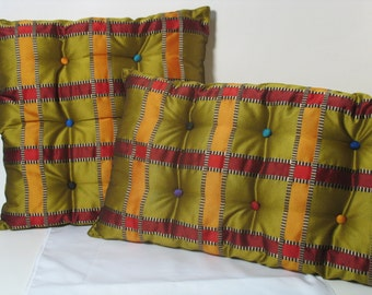 Set of 2 tufted cushions, 1 rectangular and 1 square in a striped upholstery quality fabric