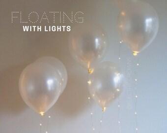 Wedding Balloons, Wedding Decor, Wedding Reception Decor, Wedding Lights, White balloons with string lights. Wedding Lighting