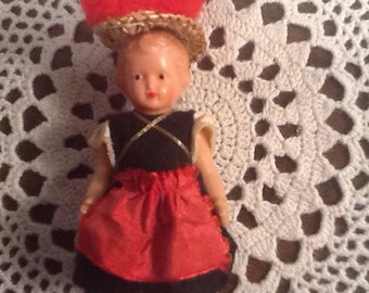"""Vintage 1950's 3"""" miniature rubber girl  with moveable arms, legs, painted mouth, eyes, stockings and shoes, doll house, crafting,"""