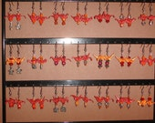 35 pairs of cranberry and orange colored origami earrings