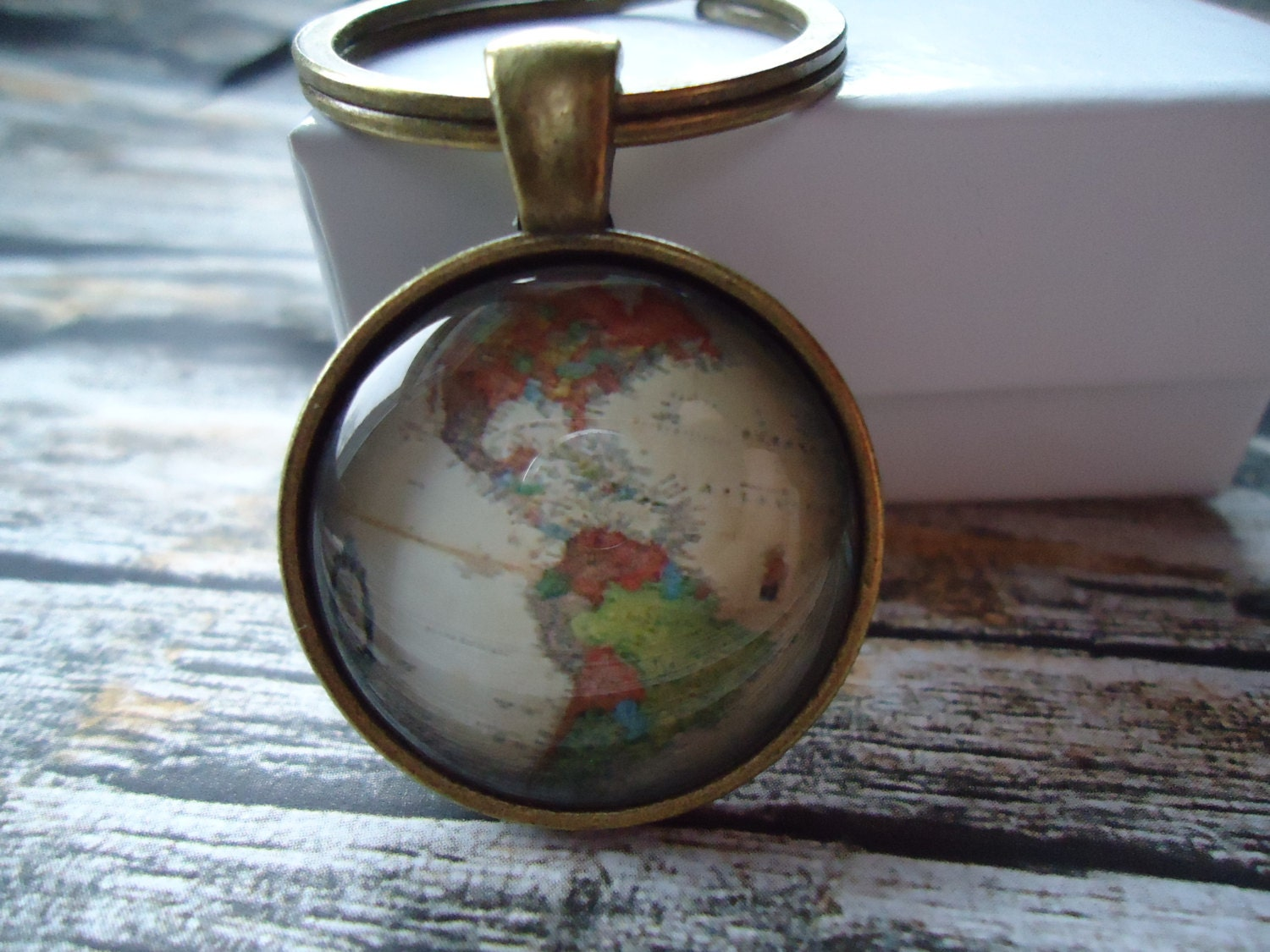 Keychains lanyards antique world map of continents bronze round statement glass domed keychain world map geography gumiabroncs Gallery