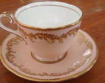 Vintage Aynsley England Bone China Peach Teacup and Saucer with Gold trim & design