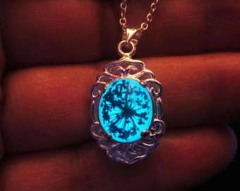 Real flower  pendant/ glow in the dark