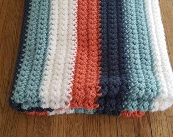 Coral, dark blue, mint, white, crocheted baby /toddler blanket.