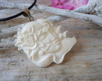 Bone and silver cameo pendant