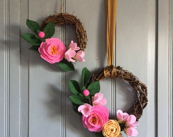 Tutti-frutti mid-size wreath; felt flowers with apple blossom, camellia, ranunculus in pink and peach