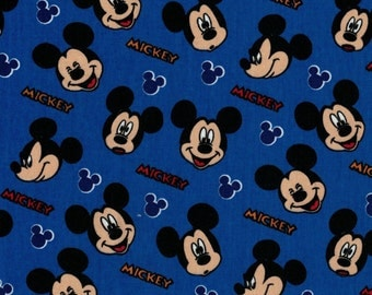 Mickey Mouse Expression Face Toss on Blue Background- Springs Creative- 100% Cotton Fabric