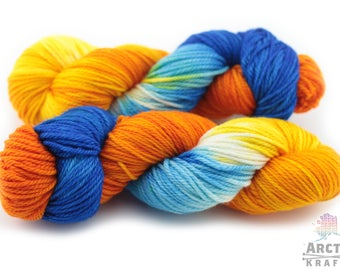 Hand dyed 100% superwash merino wool worsted/Aran weight yarn. 181 yards {Sunflowers} Indie dyed variegated yarn blue, cream, yellow, orange