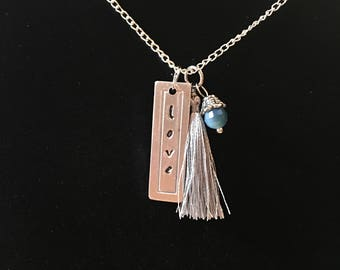 Love pendant with gray tassel and beaded charm