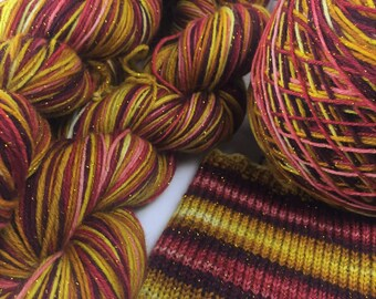 Hand dyed self striping gold sparkle sock yarn - Brave at Heart