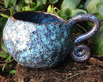 Galaxy blue ceramic mug curly handle