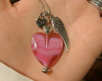 """Hope Inspired 24"""" Silver-toned Necklace - """"Charmed"""" w/hand made glass heart pendant, love, and angel wing"""