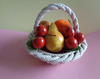 Vintage ornamenal Italian pottery majolica style woven basket of delicious looking fruit.
