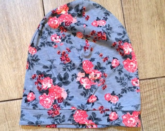 Baby girl's slouchy beanie in grey and pink floral fabric.