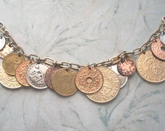 "Vintage Signed Germany Foreign Coin Charm bracelet,gold tone,8"" long,marked,lots of charms"