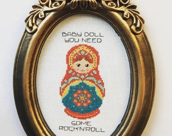 Baby doll you need some rock'n'roll. Finished and framed cross stitch.