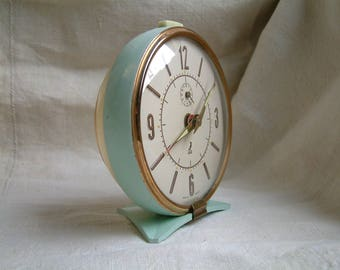 French vintage mechanical alarm clock. Pale turquoise and cream clock. Mid century modern. Loft decor. 1950s stlye.